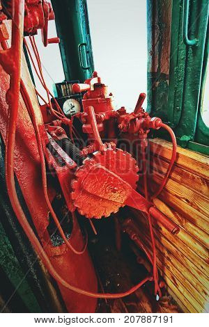 Inside the driver's cabin at an old steam locomotive. Vintage model of train driver cabin