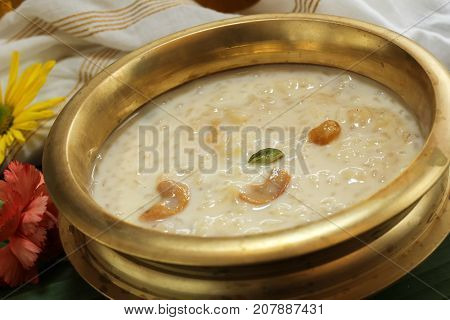 Rice Kheer / Paal (Pal) Payasam served in Traditional Brass Vessel poster