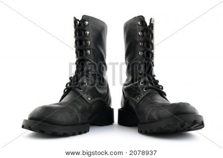 Military style black leather boots on white background. poster