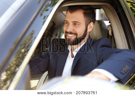 Young man on driver's seat of car