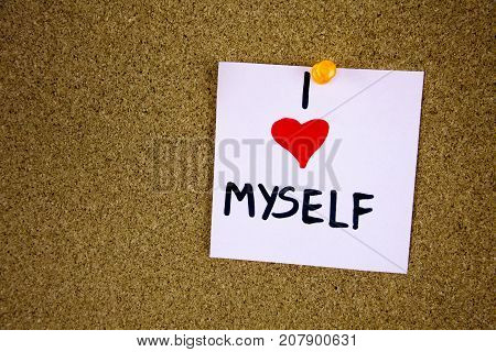 I Love Me writing on yellow note pinned on cork board background. Businnes concept