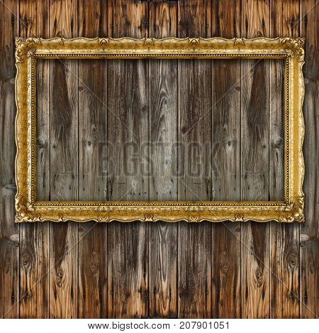 Retro Big Old Picture Frame on wooden background