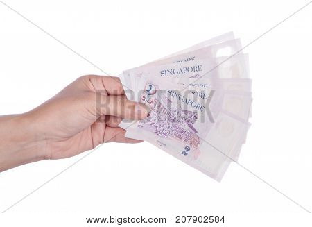 Hand With Singapore Banknotes Dollars (2 Sgd) Isolated On White Background