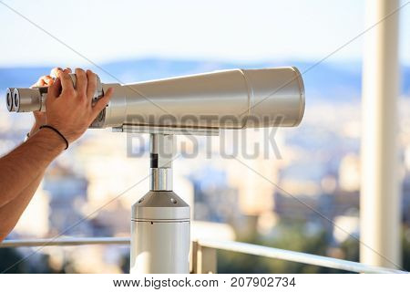 Stationary binoculars of stainless steel, selective focus on the binoculars.