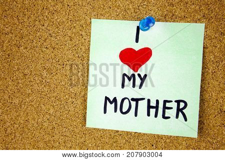 Note with I love my mother, Note with I love my mom and red heart on cork board background businnes concept