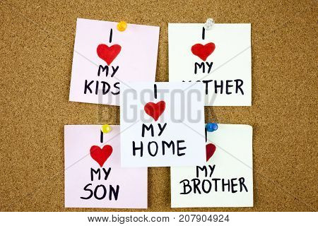 sticky notes on on cork board background with wordsI love my kids I love my mother, brother, son. Businnes concept