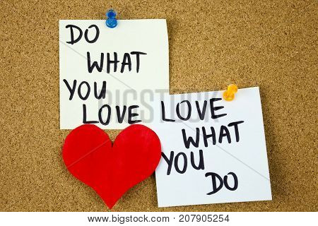 do what you love, love what you do - motivational word advice or reminder on sticky notes on cork board background. Businnes concept
