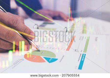 Double Exposure Of Male Manager Analyzing Data Pointing Pen At Charts And Graph To Find Out The Resu