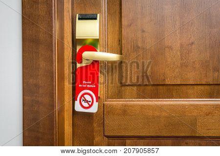 Door Of Hotel Room With Sign Please Do Not Disturb