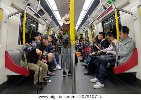 People Sitting On Subway Train In Hong Kong