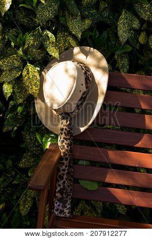 sunhat left on a garden chair on a sunny afternoon