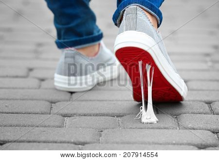Foot stuck into chewing gum on street. Concept of stickiness poster