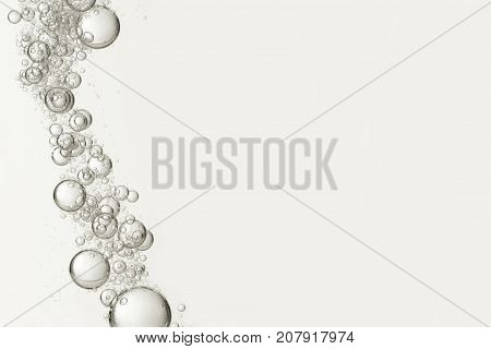Flowing bubbles is isolated over a light background.