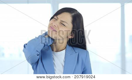 Young Businesswoman At Work With Neck Pain, Workload