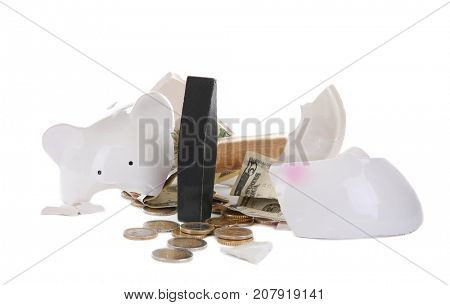 Hammer and broken piggy bank on white background