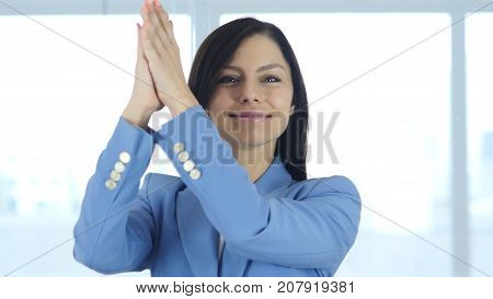 Clapping Young Businesswoman Applauding for Team in Office