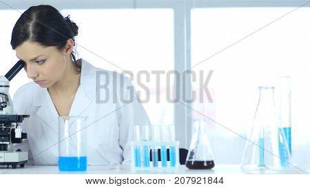 Chemist, Scientific Reseacher Working On Microscope In Laboratory