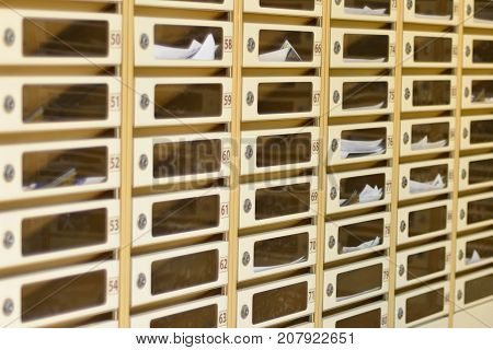 the post cubicle of an apartment building with daily mail