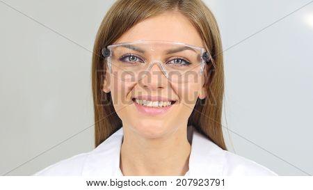 Smiling Female Chemist, Scientific Looking At Camera
