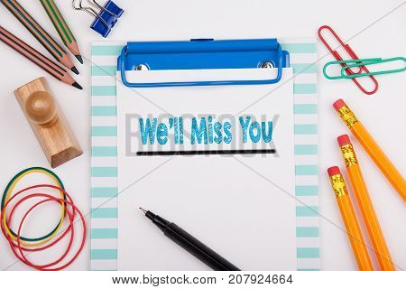 We'll Miss You. White office desk with stationery.
