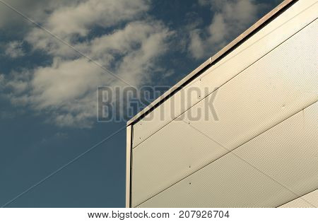 Metal Sided Warehouse Against Blue Sky.
