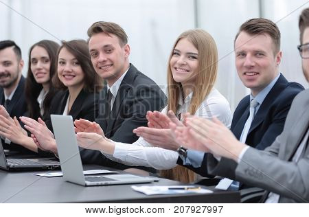 business team applauding the speaker at the workshop
