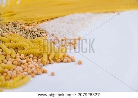 Set Of Products With Complex Carbohydrates On White Background. Wooden Spoon, A Range Of Cereals, Pa