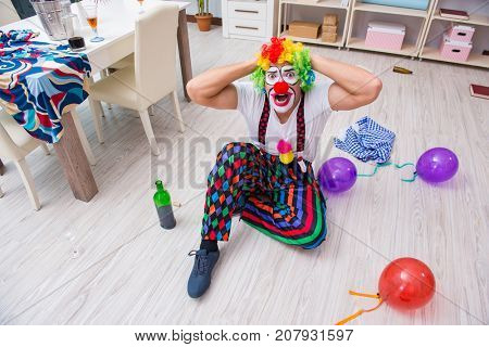 Drunk clown celebrating having a party at home