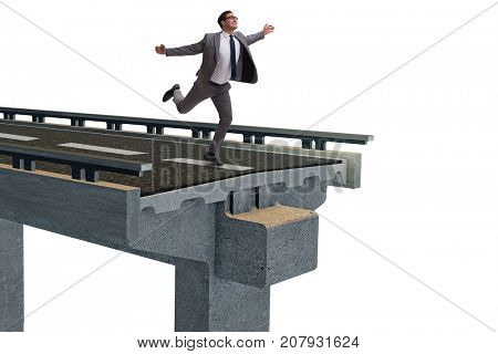 Young businessman with broken bridge isolated on white