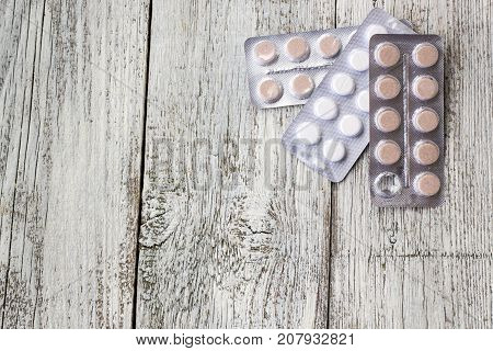 Medicine Pills In Packs.pills In Blister Pack,capsules And Pill Packed In Blisters On White Wooden B