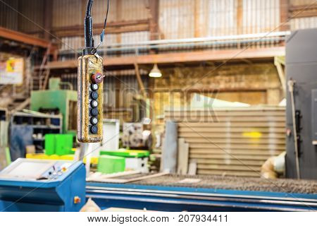Suspended push button control panel electric crane beam. Factory shop.