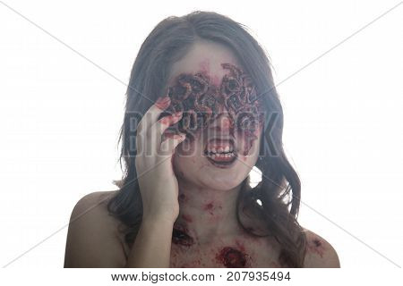 Girl with realistic sores and worms in her eyes. Creative halloween makeup. Isolated.