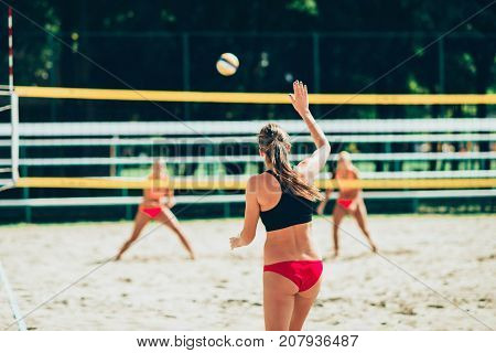 Beach Volleyball, Women Playing Volleyball Outdoors, Color Image