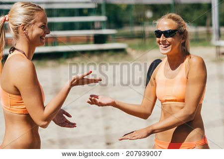 Beach Volleyball Women playing volleyball outdoors color image