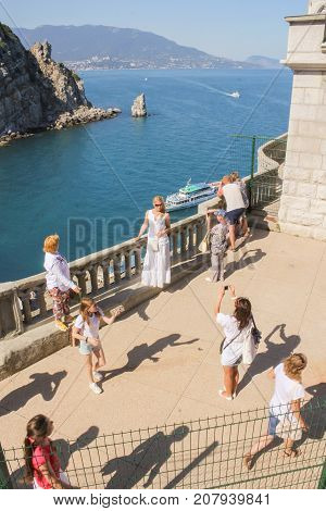 Yalta, Crimea - 11 July, Girls are photographed at the railing, 11 July, 2017. Small Castle Lastochkino Nest and its surroundings.