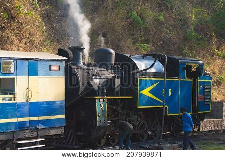 OOTY, TAMIL NADU, INDIA, 20 March 2015 : Nilgiri mountain railway. Blue train Unesco heritage Narrow-gauge