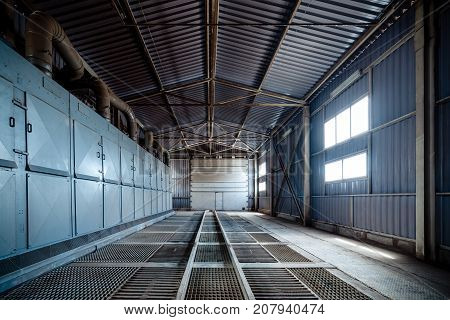 Large hangar lattice floor. A building for unloading wheat.