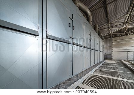 Hangar for unloading wheat. Powerful dust extraction system. Ventilation ducts and large air ducts.