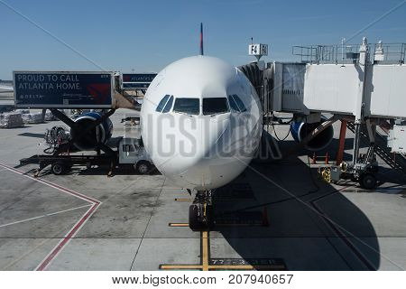 Delta Airlines Passenger Airplane Is Loaded With Cargo