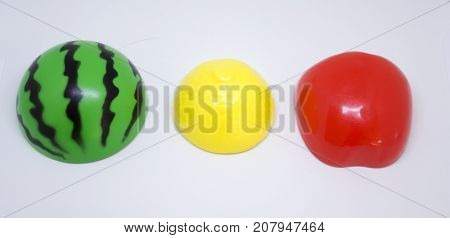 Plastic fruits in colors of traffic lights