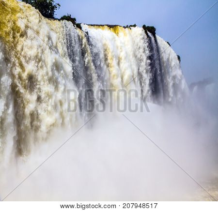 Magnificent and well-known Iguazu Falls. Complex of the most abounding in water Iguazu Falls in the world on border of Argentina, Brazil and Paraguay. Concept of active and extreme tourism