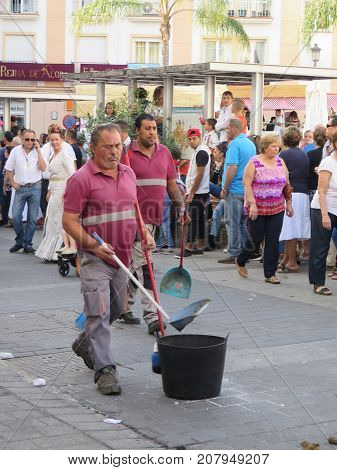 Cleaning Up After The Horses At Local Village Festival