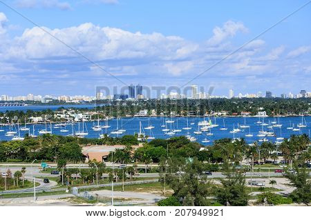 Many Sailboats with Biscayne Bay and Miami