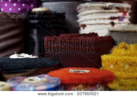 Close up shot of colourful fabric roll in fabric store.