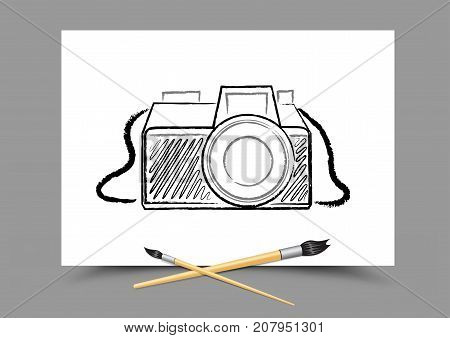 Paintbrush drawing camera on white paper on gray background. Photography lesson. Theme of education