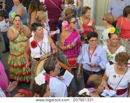 People Waiting For The Patron Saint At Local Village Festival