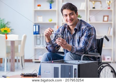 Computer repairman on wheelchair working