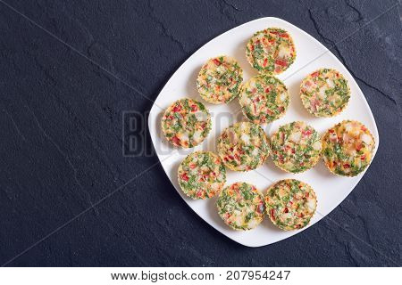 Egg muffins with onion pepper bacon and cheese