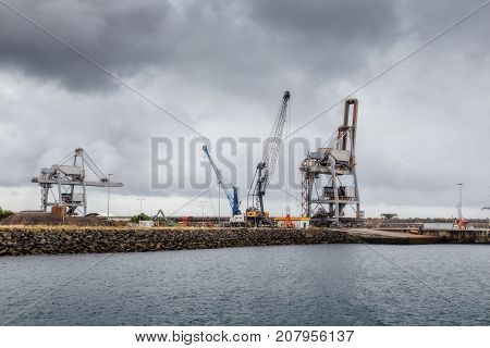 Cranes and lifts in the industrial seaport of Sines. Portugal