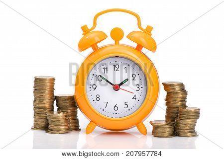 Pile Of Gold Coins And Orange Alarm Clock